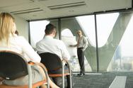 Stock Photo of Group of businesspeople attending a seminar