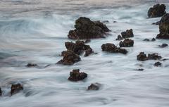 Spain, Canary Islands, Tenerife, Playa de San Juan, lava rocks at surf Stock Photos