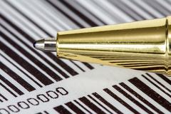 Pen on barcode background Stock Photos