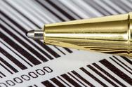 Stock Photo of pen on barcode background