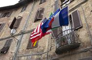 Stock Photo of Italy, Tuscany, Siena, Different flags on a balcony