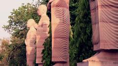 Statues of Lord Buddha's servants. Bodhgaya, India. Tilt shot. Stock Footage