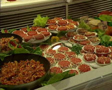 Butchery glass display meat assortment - pan Stock Footage