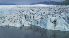 Aerial view ice glacier constantly moving under its own gravity, Arctic Region Stock Footage