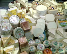 Cheese shop glass display foreign cheese assortment - pan Stock Footage