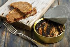sprats and black bread. - stock photo