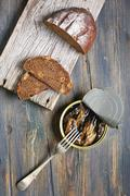 Snack - sprats and bread. Stock Photos