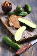 black bread and fresh cucumbers. - stock photo