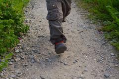 Closeup of Boy's Running Feet - stock photo
