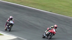 Slow motion curve at Motorbike and Superbike motorsports racing Stock Footage