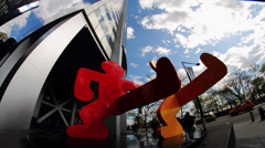 Public Keith Haring sculpture time-lapse with clouds in NYC Stock Footage