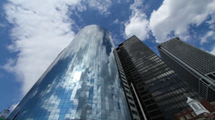 Stock Video Footage of Reflection in NYC Cylinder building wide time lapse with clouds