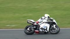 White bike at Motorbike and Superbike motorsports racing Stock Footage