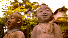 Smiling Buddha sculpture, Thailand. Video macro shift motion Stock Footage