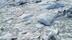 Aerial view broken off ice flows dirt and debris Stock Footage