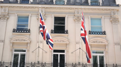 British flags in the wind attached to a bulding - stock footage
