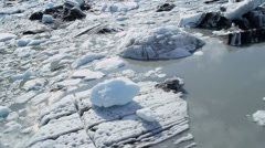 Aerial view broken off ice flows dirt and debris - stock footage