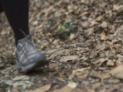 Foot running on leaves, closeup, steadycam shot, slow motion shot at 240fps Stock Footage