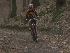 Woman riding on bike up the hill, steadycam shot Stock Footage