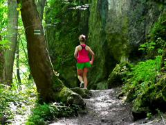 Woman joggin in forest, steadycam shot, slow motion shot at 240fps Stock Footage