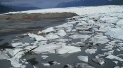 Aerial view of moraine covered ice flows from Knik Glacier, Alaska, USA Stock Footage