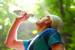 Man drinking water in forest, steadycam shot, slow motion shot at 240fps Stock Footage