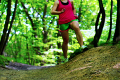 Woman jumping on path in forest, closeup,slow motion shot at 240fps Stock Footage