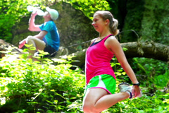 Woman exercising in forest, steadycam shot, slow motion shot at 60fps Stock Footage