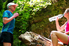Couple resting in forest, steadycam shot, slow motion shot at 240fps Stock Footage