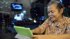 Portrait of old asian people, happy senior asia woman with looking at tablet Stock Footage