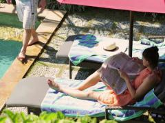 Couple relaxing on the pool Stock Footage