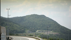 Croatian motorway road autobahn a1 enter the tunnel in the mountain Stock Footage