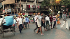 CALCUTTA, INDIA. A funeral procession in a busy intersection Stock Footage