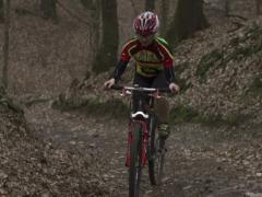 Woman riding on two-wheeler in forest, steadycam shot Stock Footage
