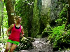 Woman running in the forest, steadycam shot, slow motion shot at 240fps Stock Footage