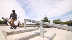 Skateboarder Does Trick Down Rail In Skatepark - stock footage