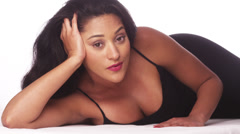 Mexican woman lying on matt Stock Footage
