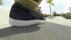POV Foot on Skateboard in Skatepark Stock Footage