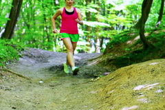 Jogger exercising on pathway, closeup, steadycam slow motion shot at 240fps Stock Footage