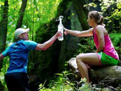 Man taking water from a woman, steadycam shot, slow motion shot at 240fps Stock Footage