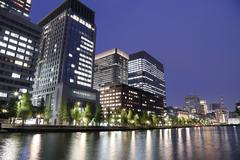 The city lights of tokyo reflect off of the water Kuvituskuvat