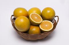a wicker casket with oranges - stock photo