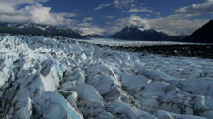 Aerial view of natures Knik Glacier moraine crevasses  Alaska, USA Stock Footage