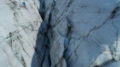 Aerial view of moraine covered deep crevasses Knik Glacier  Alaska, USA Stock Footage