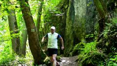 Man exercising in the forest, steadycam shot, slow motion shot at 60fps Stock Footage