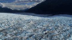 Aerial view of moraine covered Knik Glacier, Alaska, USA - stock footage