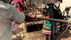 Boat arriving at the shore in a village in Bengal, India. Stock Footage