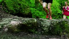 Couple running in forest, closeup, steadycam shot, slow motion shot at 240fps Stock Footage