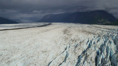 Aerial view of moraine covered Knik Glacier, Alaska Stock Footage