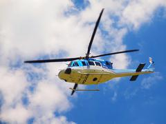 Police helicopter in action, propellers are turning and the machine fly. Stock Photos